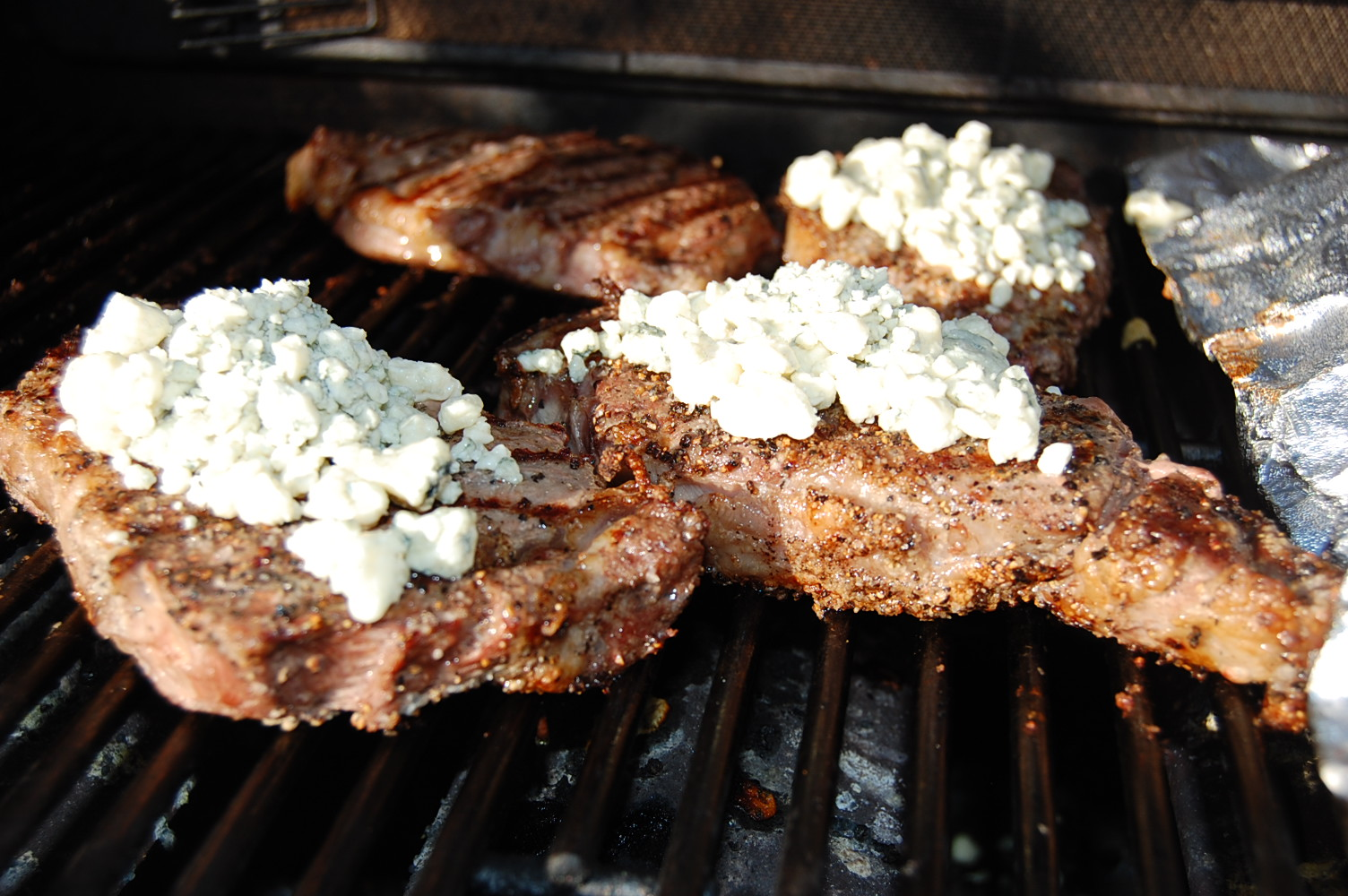 Grilled Pepper Crusted Rib Eye Steaks Topped with Bleu ...