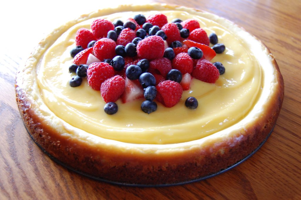 Lemon Cheesecake Topped with Lemon Curd and Fresh Berries