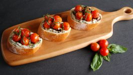 Blistered Tomato Ricotta Crostini